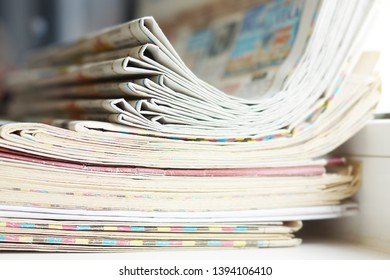 Newspaper Pages. Close up view of Stack of Magazines and Journals. Papers with News