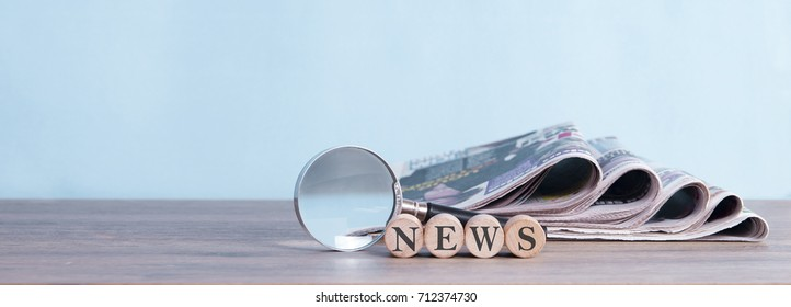 newspaper stack and magnifying glass background