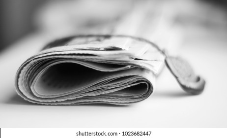 Newspaper tied up with a rope and stamp. Daily paper with news is bound with rubber seal. Folded journal on white table with fresh information, concept for communication