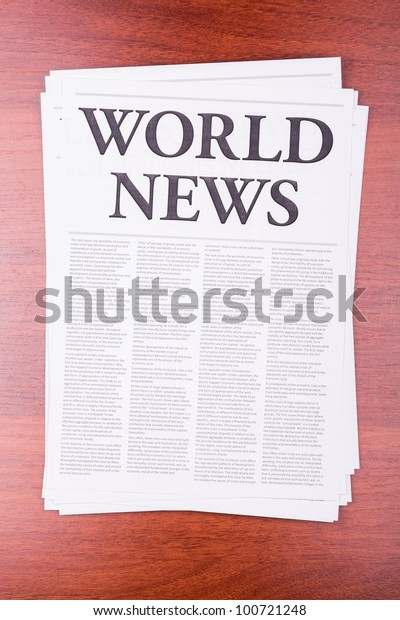 The newspaper WORLD NEWS on table