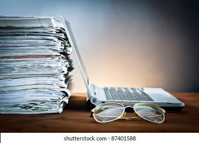 newspaper,eyeglasses and laptop