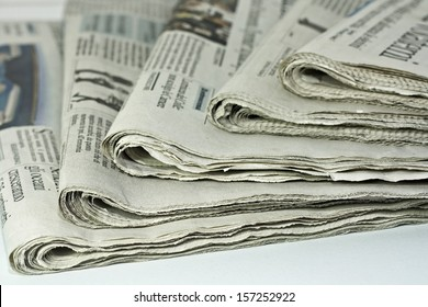 newspapers against plain background shot with very shallow depth of field