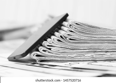 Newspapers amd Smartphone. News Pages with Headlines and Articles and Mobile Phone. Different Sources of Information - Internet or Papers. Concept for Communication