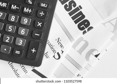 Newspapers and calculator. Pile of daily papers with news on table. Pages with headlines, articles and electronic device. Modern gadget and new journals, top view