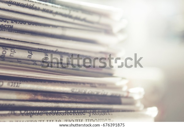 Newspapers close up background