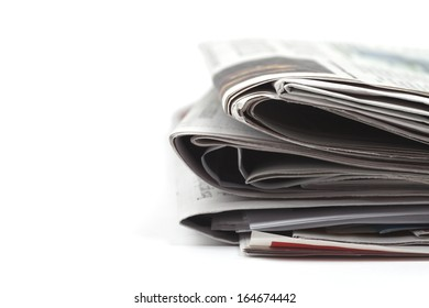 Newspapers folded, conceptual image for global communications, selective focus