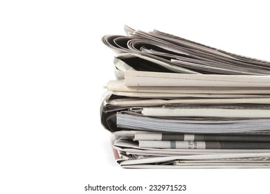 Newspapers folded, conceptual image for global communications. Macro image with shallow depth of focus