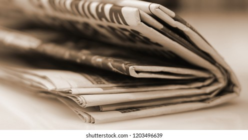 Newspapers folded and stacked concept for global communications. Newspaper, journalist, backgrounds. Newspapers and documents. Daily paper with news. Pages with text, articles.