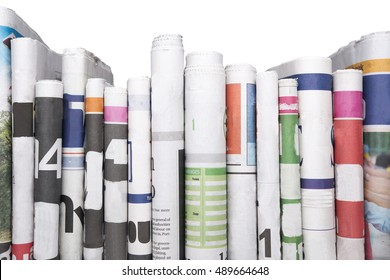 Newspapers folded and stacked isolated on white background