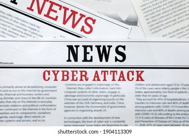 Newspapers with headline Cyber Attack as background, closeup