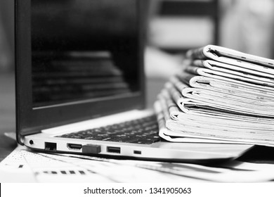 Newspapers and Laptop. Different Concepts for News - Social Network or Traditional Tabloid Journals. Data Sources - Electronic Screen of Computer or Paper Pages of Magazines, Internet or Papers