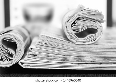 Newspapers and Laptop. Folded and Rolled Magazines against Computer Screen, Business and News Concept