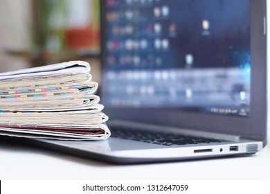 Newspapers and Laptop. Magazines and Journals and Computer. Paper Media and Electronic Device with Internet - Business News and Financial Information. Headlines, Articles and Digital Content