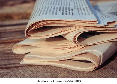 Newspapers on old wood background.