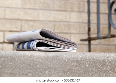 newspapers on a stairs