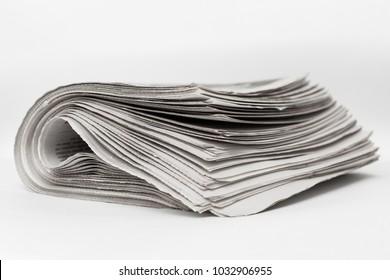 Newspapers on a white background.
