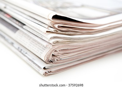 Newspapers on a white table