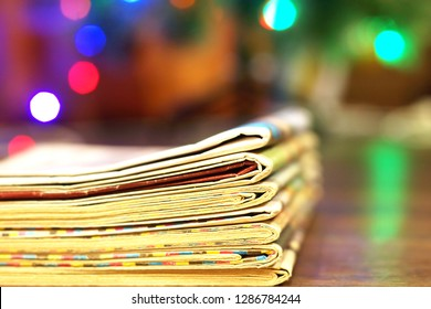 Newspapers Stacked in Pile against Blurred Background