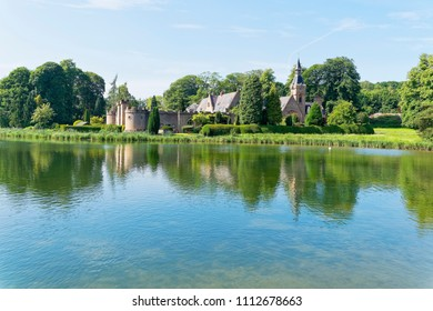 Newstead, England - June 10 2018: A building known as The Fort sits behind a castellated wall with turrets on the shore of Newstead Abbey lake.