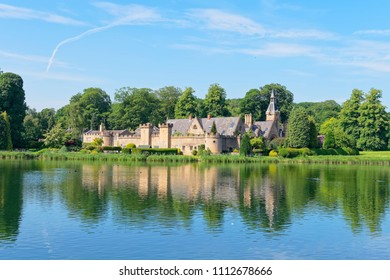 Newstead, England - June 10 2018: The Fort sits behind a castellated wall with turrets on the shore of Newstead Abbey lake in the summer sunshine