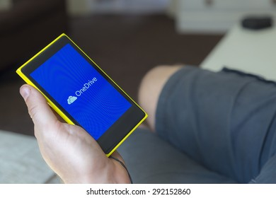 Newton abbot, Devon, UK 15 JUNE 2015 - Showing a smartphone with Microsofts Onedrive application loading, illustrative, editorial