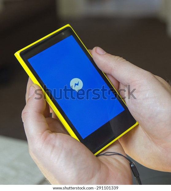 Newton abbot, Devon, UK 15 JUNE 2015 - Showing a smartphone with Facebook's messaging application loading, Illustrative Editorial