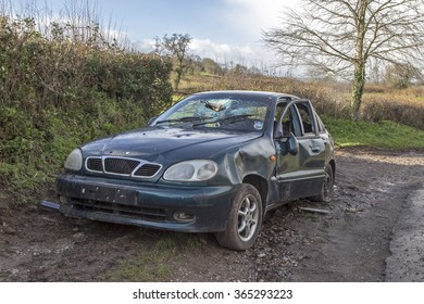 Newton Abbot, Devon, UK, January 15 2016 - Showing an abandoned and vandalised car in a country layby, with the windows smashed on a country lane between Bishopsteignton and Newton Abbot
