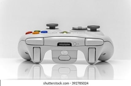 Newton abbot, Devon, UK, March 16th 2016  - Showing a Microsoft xbox360 games console controller isolated on a white background, illustrative editorial