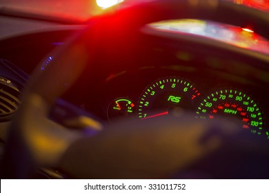 Newton abbot, Devon, UK Octoboer 16 2015 - Showing a ford focus steering wheel and parts of the instrument panel at night with illumination coming from various parts of the image.