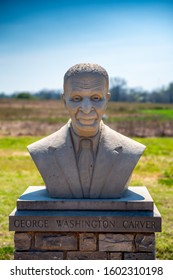 Newton County, MO—April 8, 2019; bust of iconic African American stands in front of fields at the George Washington Carver National Monument in Southeastern Missouri where he was born in the 1860s