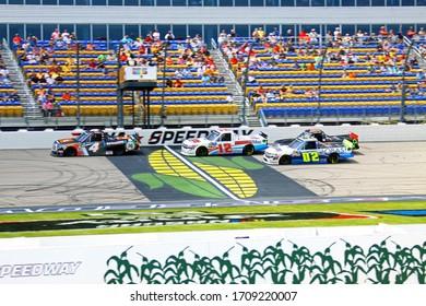 Newton, Iowa - June 15, 2019: four trucks, start finish, front straight NASCAR Gander Outdoors Truck Series M&M 300 race 2019. Iowa Speedway
