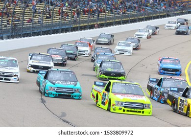 Newton, Iowa - June 16, 2019: Gander Outdoors Truck Series group of racing trucks, pack on Iowa Speedway, at the M&M'S 200 Presented by Casey's General Store. NASCAR trucks. 13 Johnny Sauter
