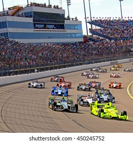 Newton, Iowa USA - July 10, 2016: Verizon IndyCar Series Iowa Corn Indy 300. Race action on the world's fastest short track. Start of the race, many cars