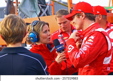Newton Iowa, USA - July 11, 2014: Verizon Indycar Series Iowa Corn 300 practice and qualifying action. NBC Sports Group motorsports reporter Kelli Stavast, interviews Scott Dixon