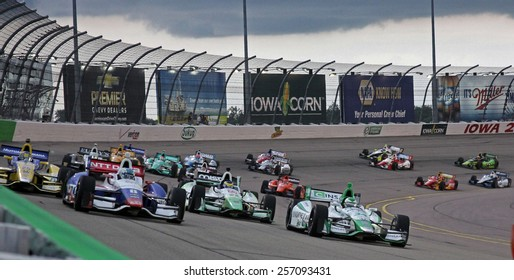 Newton Iowa, USA - July 12, 2014: Verizon Indycar Series Iowa Corn 300 on track racing action. 8 Ryan Briscoe NTT Data Chip Ganassi Racing Chevrolet, race start many cars 17 in corner