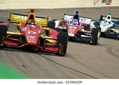Newton Iowa, USA - July 12, 2014: Verizon Indycar Series Iowa Corn 300 on track racing action. 17 Sebastian Saavedra Automatic Fire Sprinklers KV AFS Chevrolet
