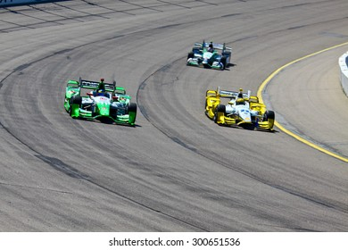 Newton, Iowa USA - July 17, 2015: Verizon IndyCar Series Iowa Corn Indy 300. 11 Sebastien Bourdais Le Mans, France Team Mistic E-Cigs - KVSH Racing Chevrolet KVSH Racing. Rounds corner on race track.