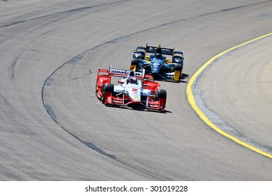 Newton, Iowa USA - July 17, 2015: Verizon IndyCar Series Iowa Corn Indy 300. 2 Juan Pablo Montoya Bogota, Colombia Verizon Team Penske Chevrolet. Pre-race practice action.