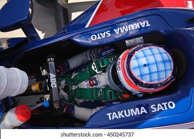Newton, Iowa USA - July 9, 2016: Verizon IndyCar Series Iowa Corn Indy 300. Takuma Sato, 2017 Indy 500 Winner, gets ready to qualify for the race.