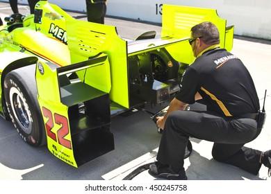 Newton, Iowa USA - July 9, 2016: Verizon IndyCar Series Iowa Corn Indy 300. Simon Pagenaud  crew member starts the car.