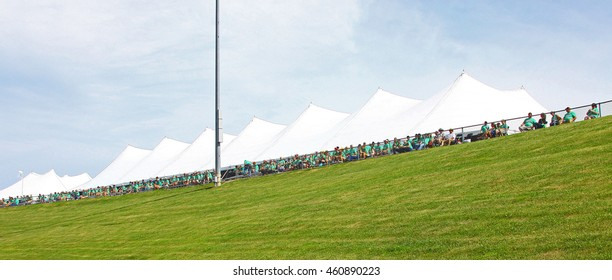 Newton, Iowa USA - July 9, 2016: Verizon IndyCar Series Iowa Corn Indy 300. Fans in the stand with sponsor: Iowa Corn Growers T-Shirts Stadium arena