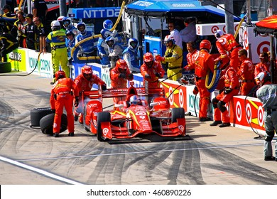 Newton, Iowa USA - July 9, 2016: Verizon IndyCar Series Iowa Corn Indy 300. Scott Dixon pit stop action splash. Indy Car Racing Teamwork