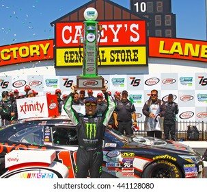 Newton Iowa, USA - June 18, 2016: Sam Hornish Jr. winner holds up event trophy. NASCAR Xfinity Series, American Ethanol E15 250 race. Iowa Speedway.