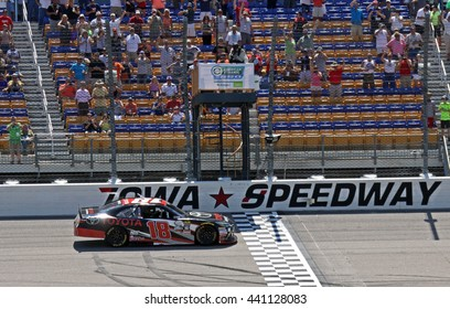 Newton Iowa, USA - June 18, 2016: Sam Hornish Jr. winner celebrates, with victory lap. NASCAR Xfinity Series, American Ethanol E15 250 race. Iowa Speedway.