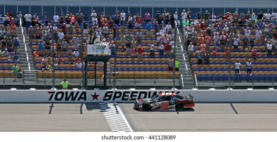 Newton Iowa, USA - June 18, 2016: Sam Hornish Jr. winner receives checkered flag at finish line. NASCAR Xfinity Series, American Ethanol E15 250 race. Iowa Speedway.