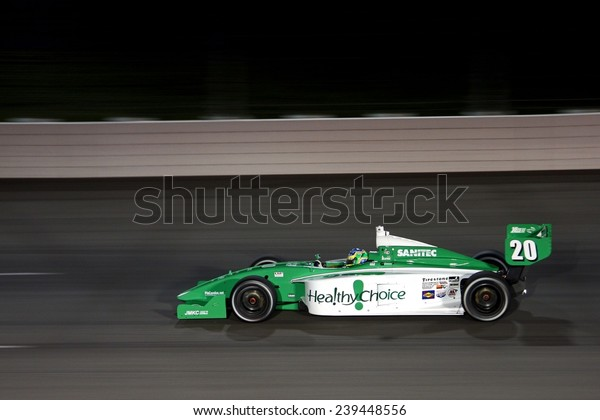 Newton, Iowa USA - June 20, 2009: Iowa Speedway, Indy Lights Miller Lite 100 race. Close action for the ladder series of Indycar. Race Winner Sam Schmidt Motorsports 20 Brazil Ana Beatriz