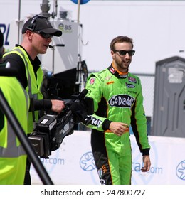 Newton Iowa, USA - June 22, 2013: Indycar Iowa Corn 250, Iowa Speedway, Practice and Qualifying sessions. James Hinchcliffe Toronto GoDaddy, followed by a camera man.