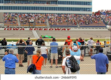 Newton Iowa, USA - June 23, 2013: Indycar Iowa Corn 250 race Iowa Speedway, celebration, driving backwards on race track. Race winner James Hinchcliffe, Canada, GoDaddy, Chevrolet, Andretti Autosport