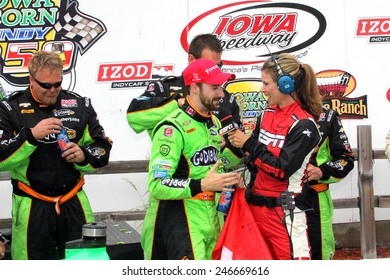 Newton Iowa, USA - June 23, 2013: Indycar Iowa Corn 250 race Iowa Speedway. Race winner James Hinchcliffe, Canada, GoDaddy, Chevrolet, Andretti Autosport, interviewed by Jamie Little