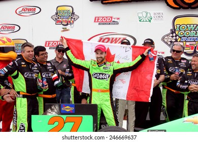 Newton Iowa, USA - June 23, 2013: Indycar Iowa Corn 250 race Iowa Speedway, Victory Circle. Race winner James Hinchcliffe, Canada, GoDaddy, Chevrolet, Andretti Autosport